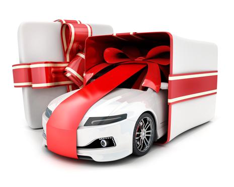 Holiday ribbon wrapped white sport coupe.